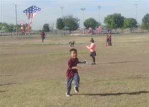 kinder student flying a kite