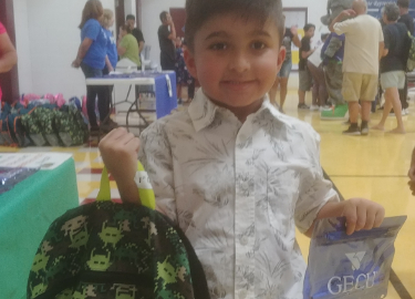 Rep. C. Blanco and GECU donate school backpacks