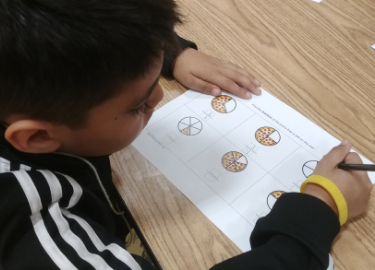 student working on fractions