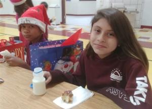 student at toy give away breakfast