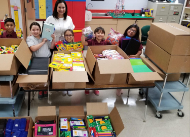 Dish Network donates school supplies