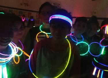 DNES Students with NO Behavior Reflection forms enjoyed a Glow stick Dance party during PE