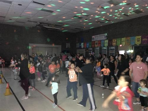 Parents and students dancing.