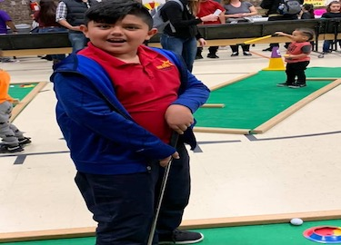 Student playing golf at the carnival