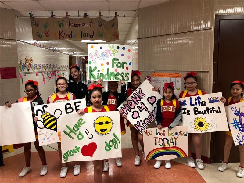 Cheer Team spreading Random Act Of Kindess messages.