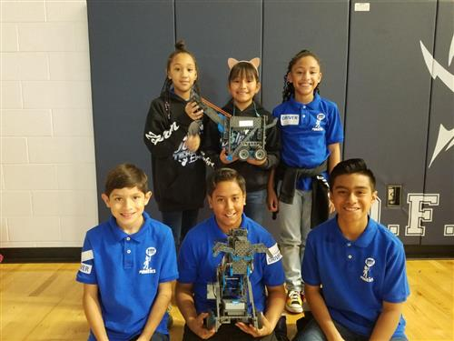 Students pose with their robots during the 1st Annual YISD VEX IQ Challenge