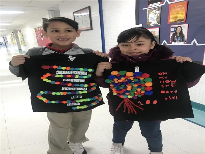 Mesa Vista students show their 100 theme shirts celebrating 100 days of school.