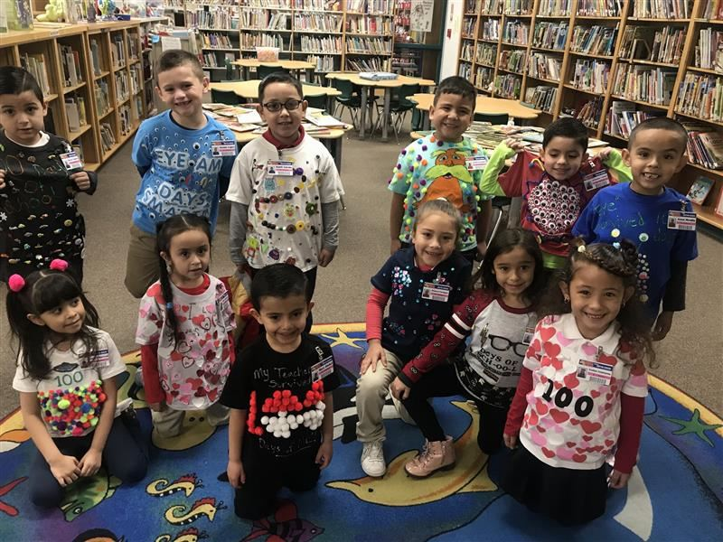 Students celebrate in the Mesa Vista Library the 100 days of school.
