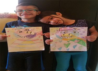 Students displaying their artwork.