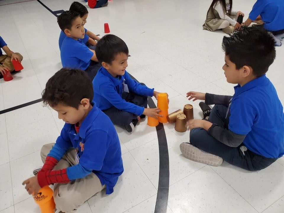 Students having fun participating in World Cup Stacking Challenge.