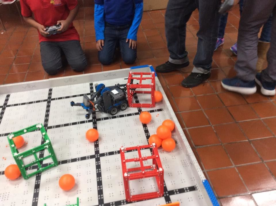 Students get practice time before taking their turn the Robotics Tournament.