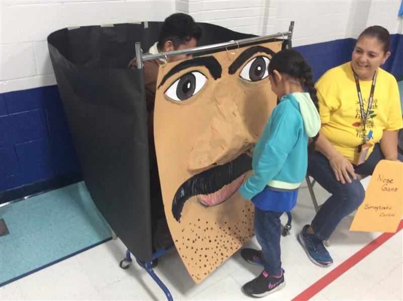 A student plays pick the giant nose game.