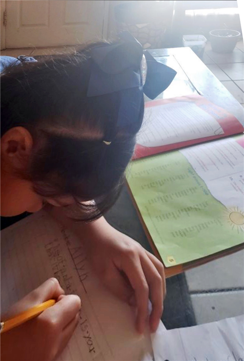 A student working on writing.