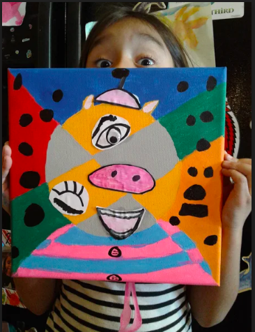 A student shows her artwork.