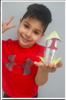 A student shows their 3d shape.