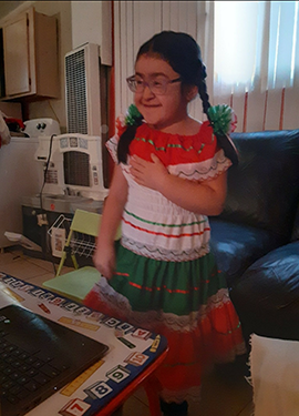 Student dressed in traditional Mexican outfit.