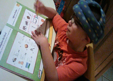 A student working in his workbook.