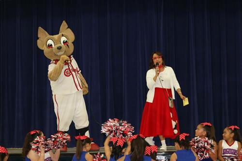Picture of Mrs. Santos with Chico from the El Paso Chihuahuas