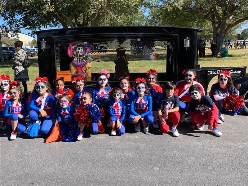 Cheer and Dance team participate in KLAQ Halloween parade