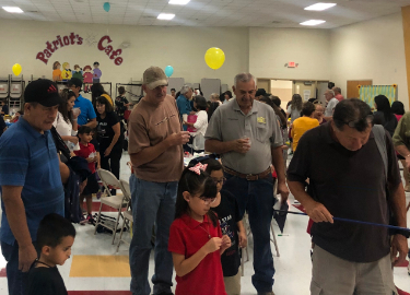 Families having fun at Grandparents' Day Celebration