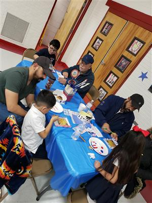 Veterans and children decorating frames to honor their service