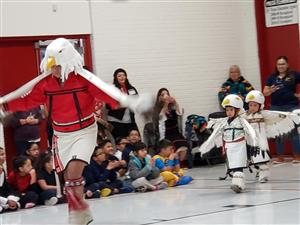 Young eagle dancers follow the Adult Eagle in ceremonial dance