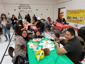 Families enjoying lunch together at Presa.