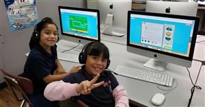 Students smiling about their success in coding