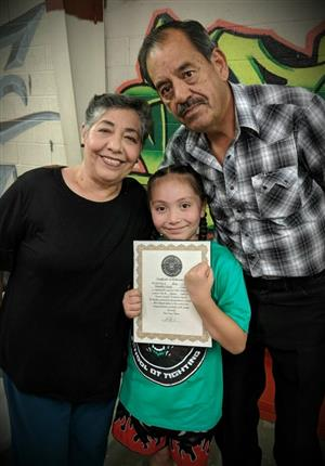 Grandparents celebrate award with granddaughter