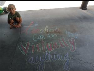 Teacher chalked thank you with proud student