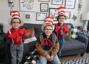 3 Brothers celebrating hat day