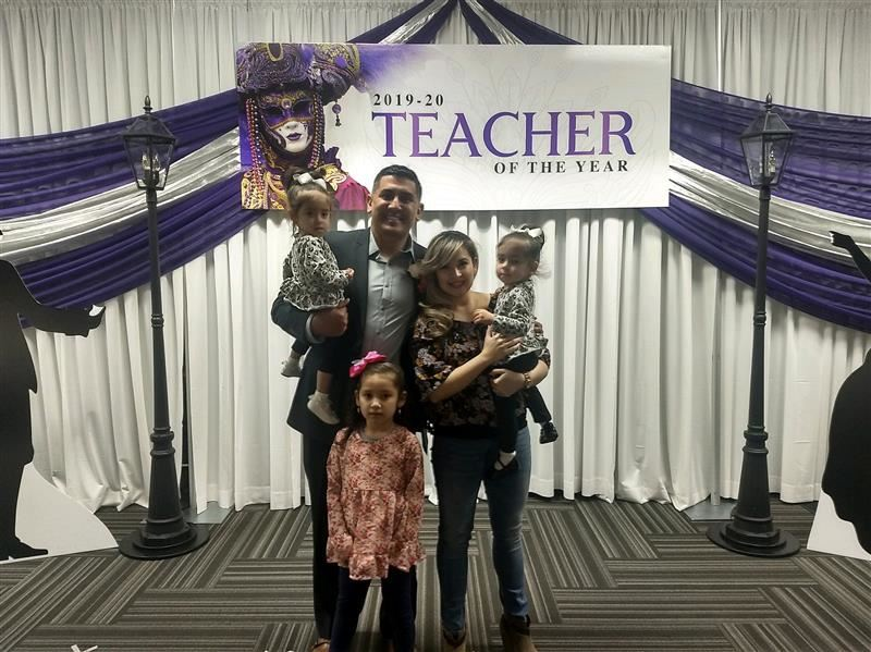 Picture of Teacher of the year Mr. Arriaga and family.