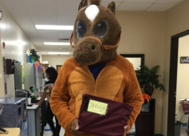 Ysleta district worker dressed up as a horse for Halloween