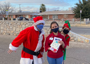 Santa and his Elves bring cheer to faculty and staff