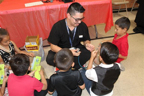 Community members volunteer their time to share their profession with students.