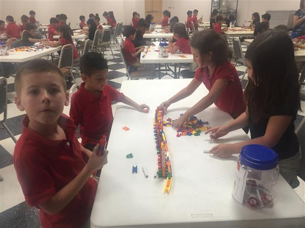 Kinder students work on bridge STEAM challenge