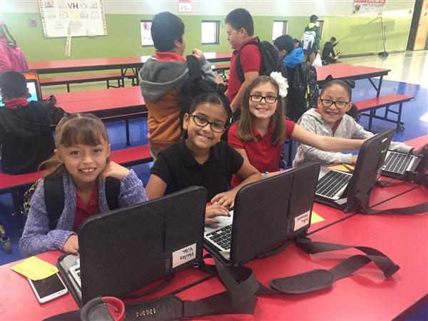 Third grade students utilizing Tech Cafe