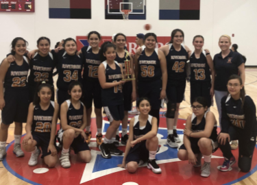 7th grade girls basketball team poses with runner-up trophy.