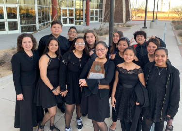 RMS Choir group poses with sweepstakes trophy