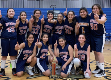 RMS 7th grade girls basketball team poses for picture with championship trophy