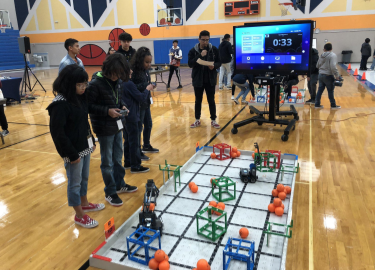 Riverside feeder pattern students compete in a robotics scrimmage.
