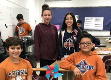 Group of RMS students pose with their finished STEM project