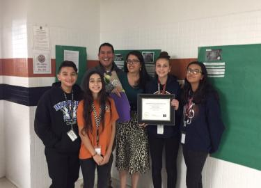 RMS Teacher of the Year Dora Valero poses with students and principal
