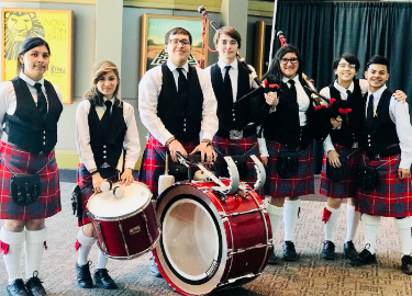 Big Red Bagpipe Band greets guests