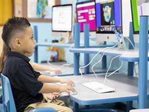 Pre K student with computer