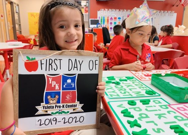 Teddy Bear Student Holding 1st Day of School Sign