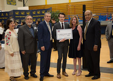 Board Member Rosales and Ramirez take picture with YEF President Dr. Perez and Eastwood HS student