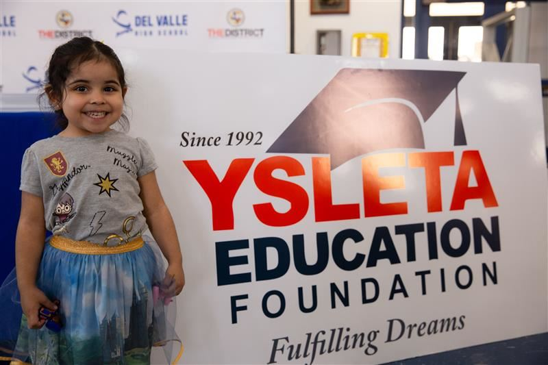 Sibling of YEF Recipient waiting for surprise presentations of a scholarship for her older sister.